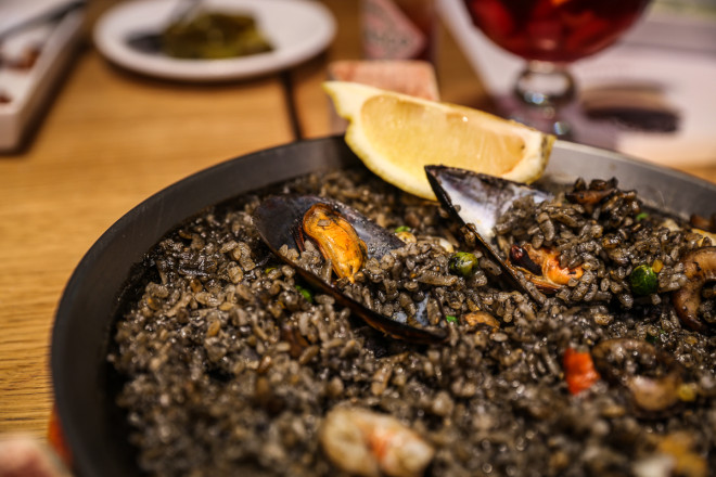 Black rice and seafood Paella