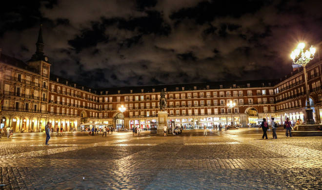 The Plaza Mayor was built during the Habsburg period and is a central plaza in the city of Madrid, Spain. It is located only a few Spanish blocks away from another famous plaza, the Puerta del Sol. The Plaza Mayor is rectangular in shape, and is surrounded by three-story residential buildings having 237 breathtaking balconies facing the Plaza.