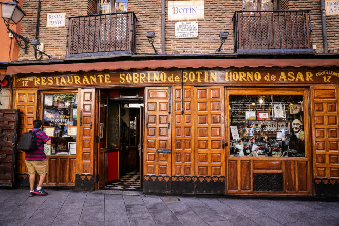 Sobrino de Botín (Calle de los Cuchilleros 17, 28005 Madrid, Spain) is a restaurant established in 1725. Along with Den Gyldene Freden (opened in 1722), it is one of the oldest eateries at its original location in the world. The artist Francisco de Goya worked there as a waiter while waiting to get accepted into the Royal Academy of Fine Arts.