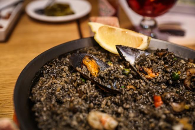 Black rice and seafood Paella