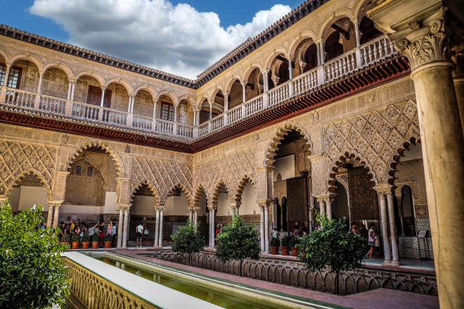 The Alcázar of Seville is a royal palace in Seville, Spain, originally a Moorish fort. It is the oldest royal palace still in use in Europe, and it was registered in 1987 by UNESCO as a World Heritage Site, along with the Seville Cathedral and the General Archive of the Indies