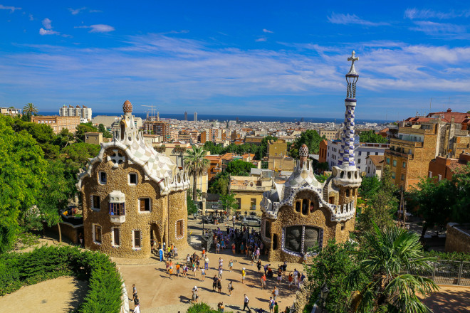 Park Güell is a garden complex with architectural elements situated on the hill of El Carmel in the Gràcia district of Barcelona